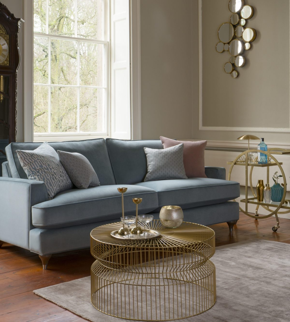 Hoxton Grand Sofa in Bracklyn Teal with Wenlock Teal Charlotte Teal and Bracklyn Blush scatters
