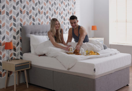 Uno Mattress Lifestyle Image Couple In Bed With Breakfast 3